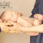 parents-holidng-newborn-baby-in-hands
