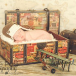 traveler-set-newborn-baby-in-suitcase-airplane-santa-monica-photography