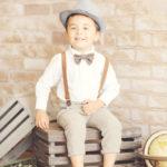 Traveler-Set-Brick-Background-Aviator-Styled-Boy-Kids-Portraits-Best-Studio-Santa-Monica