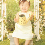 Best-First-Birthday-Photographer-One-Year-Old-Girl-Studio-Grass-Set-Sun-Glow-Garden-Spring-Styled-Brentwood