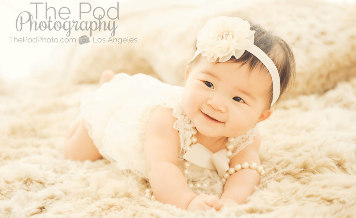Cute-Baby-Girl-Romper-Headband-Pearls-Tummytime-Six-Months-Baby-Photographer-Brentwood-Studio