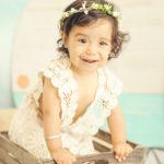 One-Year-Old-Baby-Girl-Portriats-Bohemian-Flower-Headband-Crochet-Dress-Baby-In-Bucket-Venice-Beach-Photographer