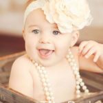 Smiling-Baby-In-Basket-Big-Girly-Headband-Pearls-Styling-Full-Service-Studio-Venice-Beach