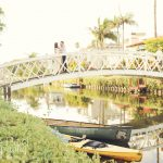 venice canals couple on a bridge