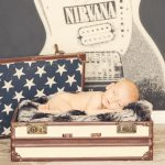 rocker baby nirvana poster newborn sleeping in sutcase