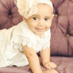 Baby-Girl-Tummy-Time-On-Couch-Best-Baby-Photographer-Brentwood