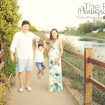 family swingign boy in the air t the venice grand canal in marina del rey