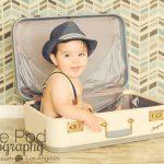 Manhattan-Beach-Baby-Photographer-Traveler-Set-Suitcase-Trunk-Blue-Green-Teal-Suspenders-Hat-Modern-Chevron-Background