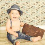 Best-Baby-Portraits-Manhattan-Beach-Traveler-Set-Suitcase-Trunk_Suspenders-Jeans-Hat