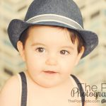 Baby-Boy-Portraits-Los-Angeles-Fedora-Suspenders-Blurry-Background-Close-Up