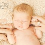 baby holding parents fingers newborn baby
