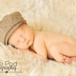 newborn-baby-in-a-newsboy-hat