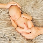 parents-holding-baby-clssic-newborn-photography-manhattan-beach
