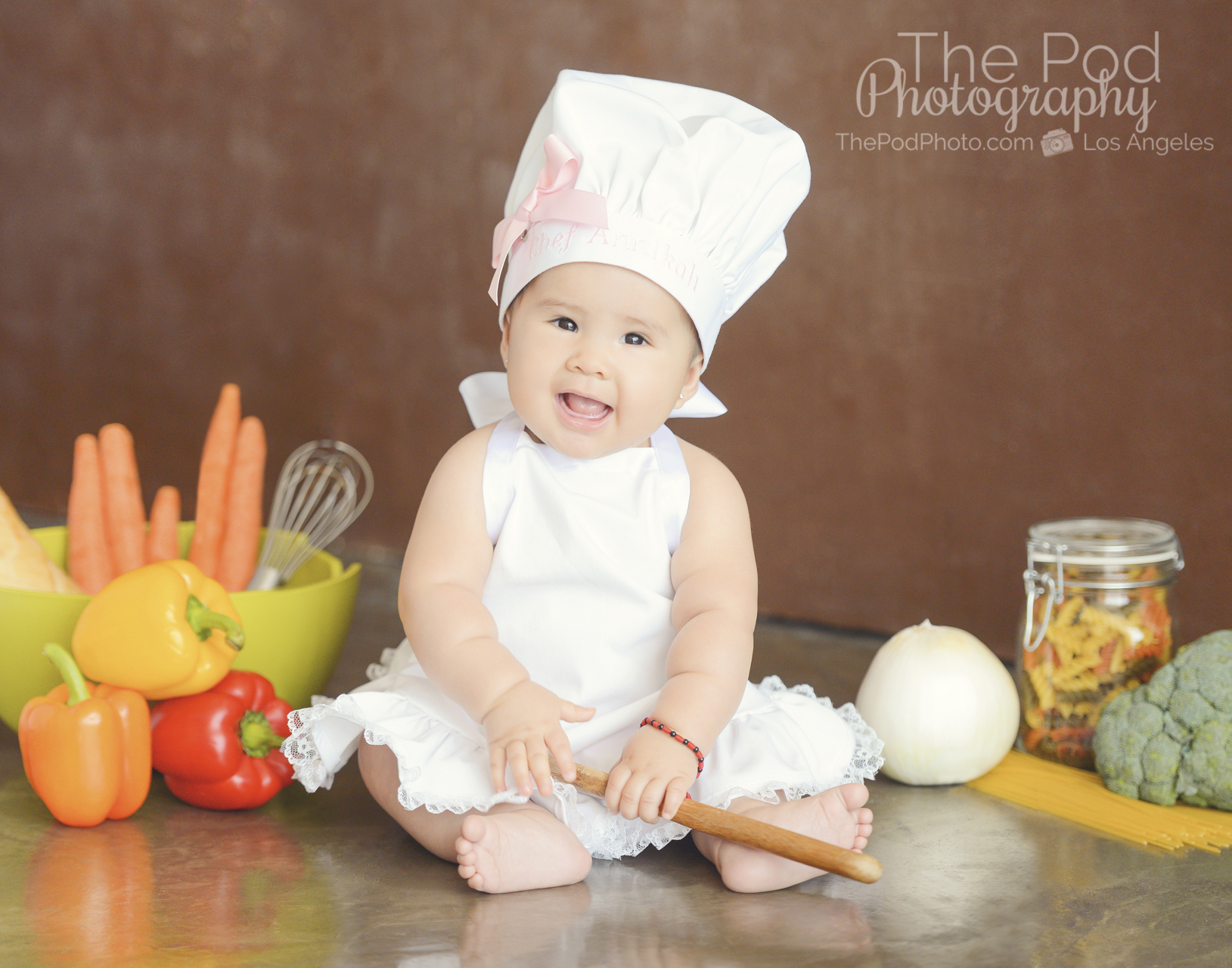 Six month portrait session los angeles baby chef inspired by anne geddes