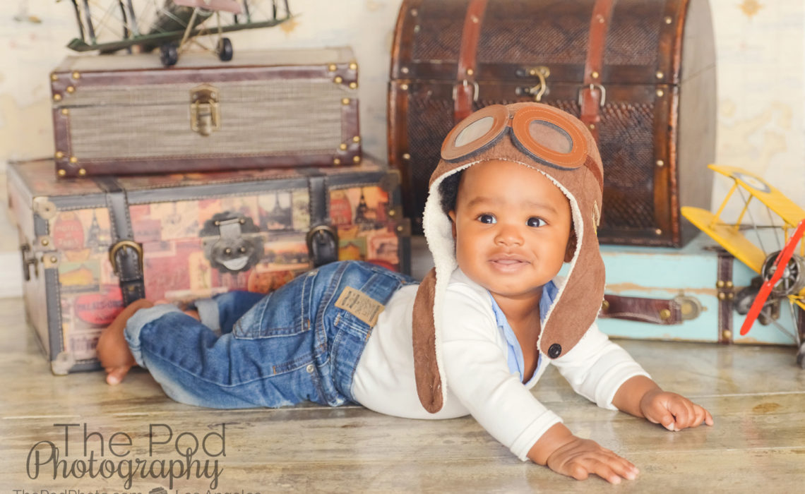 baby-with-trunk-props-traveler-theme-photos