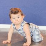 baby-boy-crawling-in-romper
