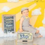 you-make-me-happy-when-skies-are-gray-first-birthday-photos