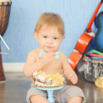baby-eating-first-birthday-smash-cake-music-theme
