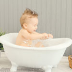 splashing-in-the-tub-first-birthday