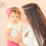 kissing-baby-cheeks-photo-studio