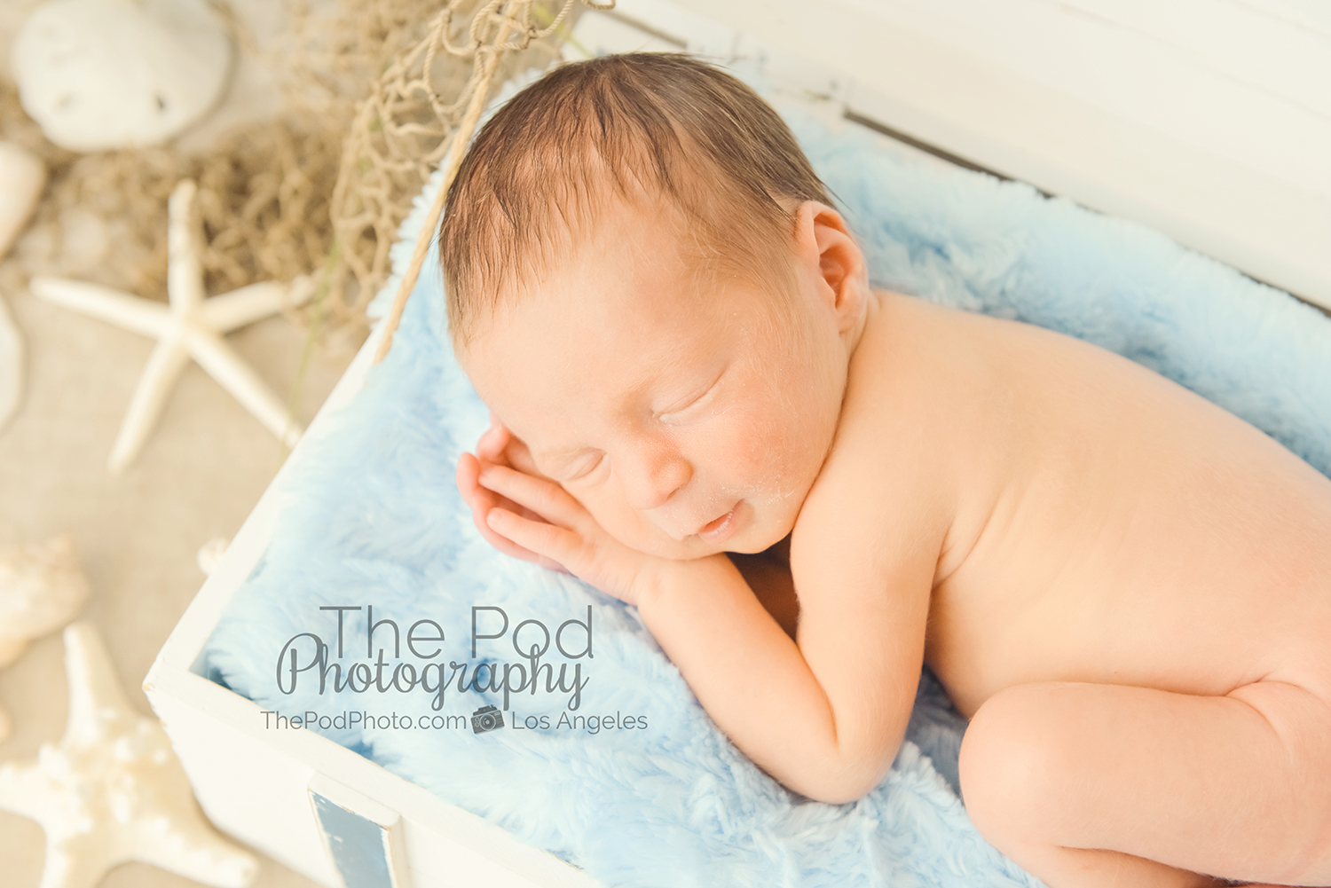 Beach themed newborn pictures