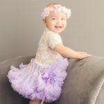 standing-up-child-at-photo-studio-in-tutu
