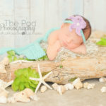 baby-laying-on-beach-st-in-mermaid-costume