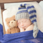 cute-baby-cuddling-bear-professional-photo-studio