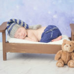 infant-sleeping-in-tiny-bed