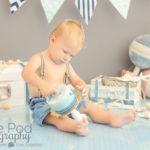 one-year-boy-knocking-cake-over