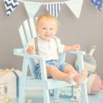 one-year-old-boy-sitting-in-blue-beach-chair