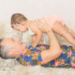 holding-baby-in-the-air-fathers-day-shoot