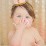 one-year-old-baby-girl-eating-pink-smash-cake