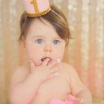 first-birthday-girl-eating-cake