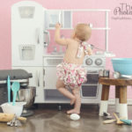 baby-girl-playing-in-kitchen