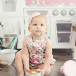 baby-kneeling-holding-smash-cake