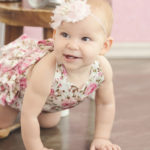 baby-girl-crawling-in-floral-romper