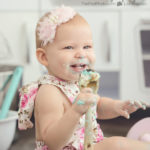 one-year-old-girl-celebrating-birthday-with-cake