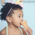 Baby girl eating ice cream cone