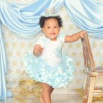 one-year-old-baby-standing-in-blue-tutu
